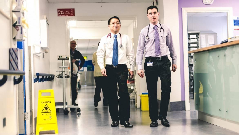 Trainees walking in hospital.