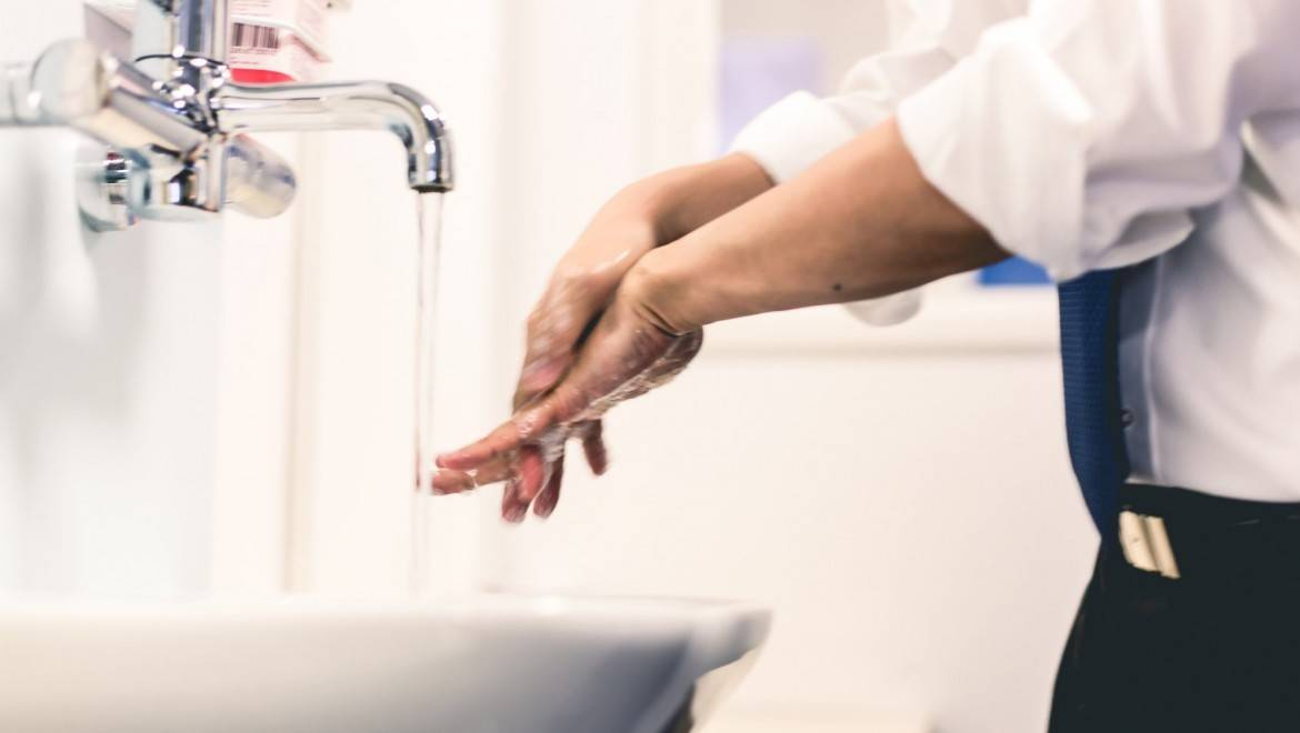Doctor washing hands.