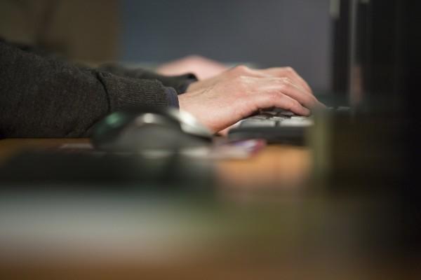 Trainee using computer.