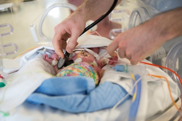 Doctor attends to neonate